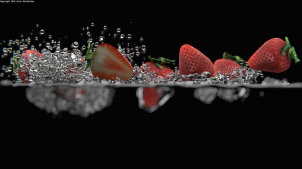 3D strawberries splashing into CG water simulation © Kyler Michaelson
