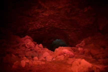 Bear trap cave lava tube with red and blue light