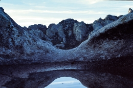 This is a puddle on top of an enormous boulder