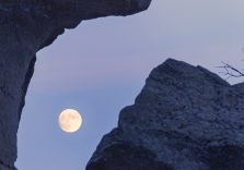 The moon peaking through a stone formation in City of Rocks, Idaho