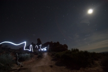 Light painting in the moonlit desert.