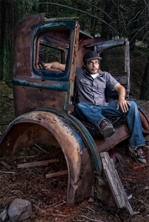 This is a self portrait I made for Advanced Photo Media. The location is at a spot called Pass Creek in Leslie, Idaho. I have always loved camping around here, and one day I came upon this old '27 Chevy rusting away in the mountains. There is no road leading to this area, but there are the remains of an old bridge made of 2x6 planks going across a small ravine that hints at how this car got here so many years ago. This image tells my story because of the link to the place, and because when I was a teenager I used to restore classic cars like this one with my dad and uncles.