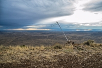 This image represents isolation by showing this tattered flag posted at the summit of Big Southern Butte. The butte is located all alone in the Idaho desert, and this flag stands alone in the ripping wind that perpetually rakes this cliff face. This is a popular location for hang glider pilots to jump.
