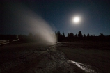 Geyser backlit by the full moon
