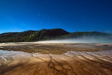 I had to shoot the mountains and stars reflecting off the waters of Grand Prismatic Pool. You can see Mars and just barely make out the Milkyway.