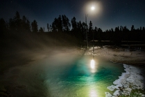 Full moon reflecting off a prismatic pool at Geyser Basin in Yellowstone National Park